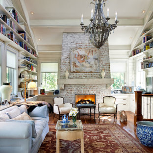 Living room library - rustic open concept medium tone wood floor living room library idea in Denver with white walls, a standard fireplace and a brick fireplace
