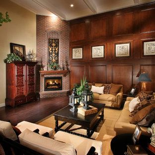 Living room - traditional medium tone wood floor living room idea in Denver with beige walls, a corner fireplace, a brick fireplace and no tv