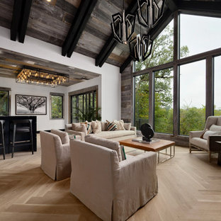 Living room - contemporary open concept light wood floor, beige floor, exposed beam, vaulted ceiling, wood ceiling and wood wall living room idea in Kansas City with white walls