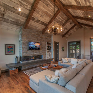 Design ideas for a medium sized rustic living room in Denver with grey walls, medium hardwood flooring, a ribbon fireplace, a stone fireplace surround and a wall mounted tv.