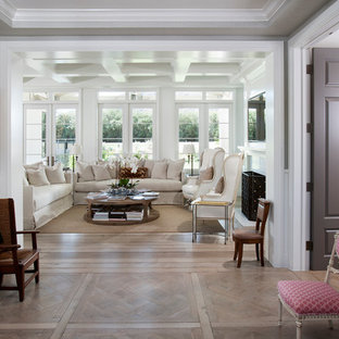 Example of a french country open concept light wood floor living room design in Los Angeles with white walls