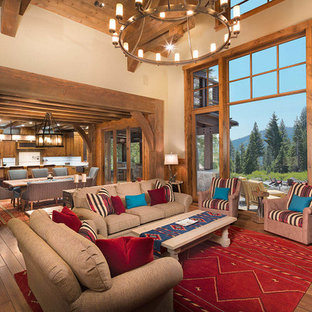 Large mountain style open concept and formal dark wood floor living room photo in Other with beige walls, a standard fireplace, a stone fireplace and no tv