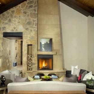 デンバーのラスティックスタイルのおしゃれなLDK (ベージュの壁、標準型暖炉、石材の暖炉まわり、テレビなし、フォーマル) の写真