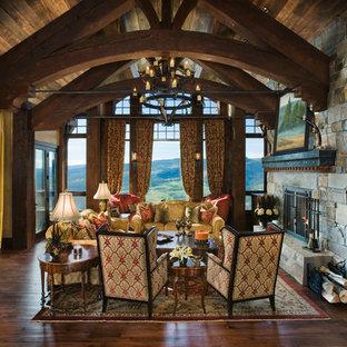 Foto di un ampio soggiorno rustico con camino classico, cornice del camino in pietra e nessuna TV