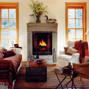 Inspiration for a medium sized rustic living room in Seattle with a standard fireplace and beige walls.