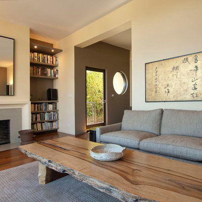 Enclosed brown floor living room photo in San Francisco with beige walls, a standard fireplace and no tv
