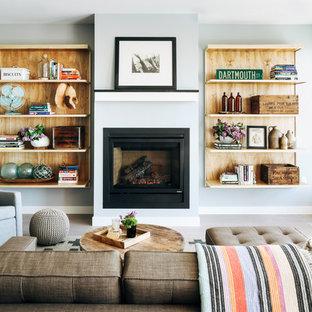 Réalisation d'un salon tradition de taille moyenne et ouvert avec une salle de réception, un mur gris, une cheminée standard, sol en stratifié, un manteau de cheminée en métal, aucun téléviseur et un sol gris.