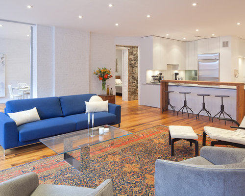 Example Of A Trendy Open Concept Living Room Design In New York With White  Walls