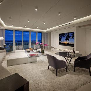 Ejemplo de salón con rincón musical abierto, contemporáneo, grande, sin chimenea, con paredes blancas, suelo de piedra caliza y pared multimedia