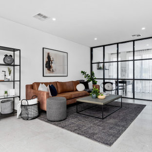 Inspiration for a mid-sized scandinavian open concept living room in Perth with white walls and grey floor.