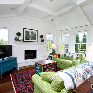 Example of a classic living room design in Indianapolis with white walls