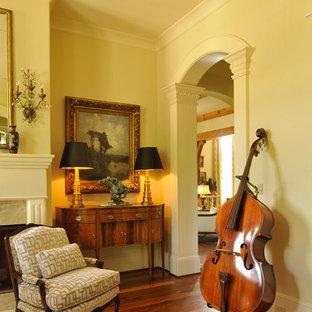 ナッシュビルの大きいトラディショナルスタイルのおしゃれなLDK (ミュージックルーム、白い壁、無垢フローリング、標準型暖炉、石材の暖炉まわり、テレビなし) の写真