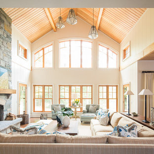 Large coastal open concept medium tone wood floor living room photo in Toronto with white walls, a standard fireplace and a stone fireplace