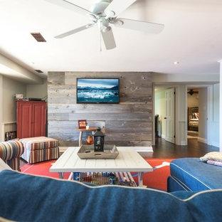 トロントの大きいビーチスタイルのおしゃれなリビング (グレーの壁、濃色無垢フローリング、暖炉なし、壁掛け型テレビ、茶色い床) の写真