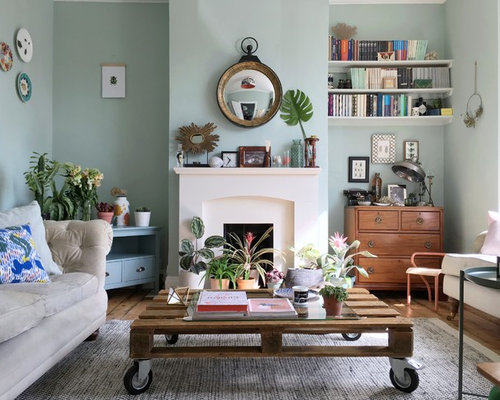 Small Eclectic Enclosed Medium Tone Wood Floor And Brown Floor Living Room  Photo In London With