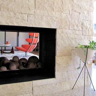 Mid-century modern living room photo in Orange County