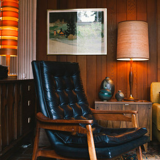 Inspiration for a medium sized retro formal enclosed living room in Seattle with brown walls, brick flooring, a standard fireplace, a brick fireplace surround and no tv.