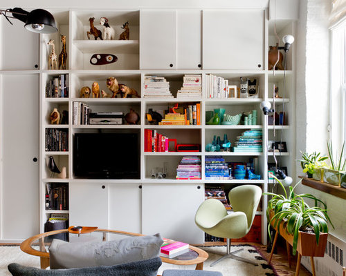 Organizing Living Room. Example of an eclectic enclosed living room library design in New York with  a media wall Organizing Bookcase Houzz