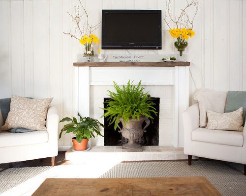 Traditional Living Room Idea In Boston With A Standard Fireplace And Wall Mounted Tv