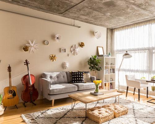 Wonderful Industrial Medium Tone Wood Floor And Brown Floor Living Room Idea In San  Francisco With Beige