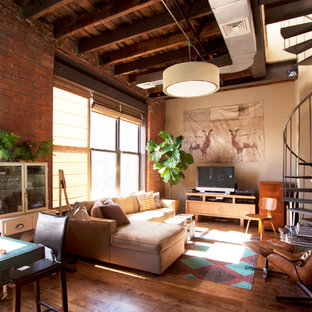 Example of an urban living room design in New York with beige walls and a tv stand