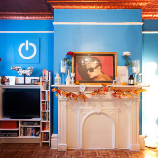 Inspiration for an eclectic medium tone wood floor living room remodel in New York with blue walls and a media wall