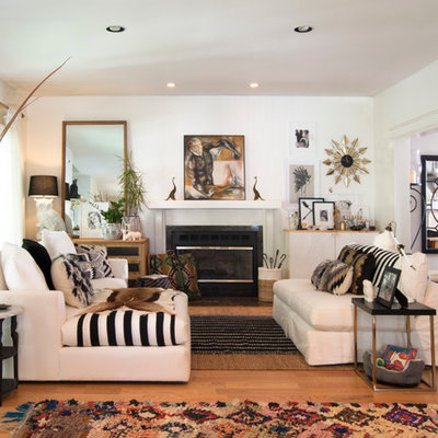 Mid-sized eclectic formal and open concept medium tone wood floor living room photo in Cleveland with white walls, a standard fireplace and no tv