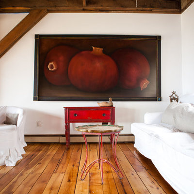 Inspiration for a cottage medium tone wood floor living room remodel in Burlington with white walls
