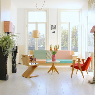 This is an example of a scandinavian living room in Amsterdam with white walls and white floors.