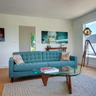 Immagine di un soggiorno contemporaneo con pavimento in sughero e pareti bianche