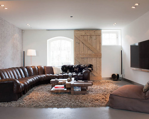 Example Of A Trendy Concrete Floor Living Room Design In Amsterdam With A  Wall Mounted