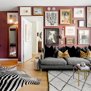 Living room - eclectic open concept light wood floor living room idea in New York with purple walls