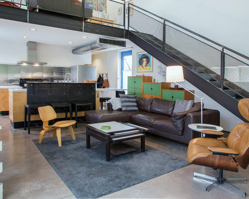 Inspiration For An Industrial Loft Style Concrete Floor And Gray Floor Living  Room Remodel In