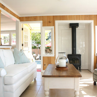 Inspiration for a small timeless living room remodel in San Francisco with a wood stove