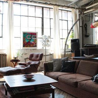 Example of an urban open concept medium tone wood floor living room design in Montreal