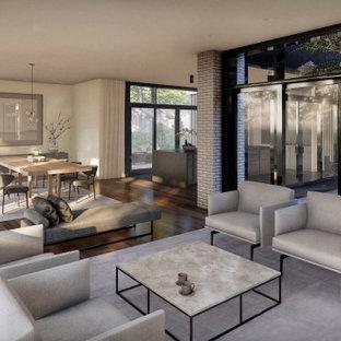 Foto de salón abierto y ladrillo, moderno, ladrillo, con suelo de madera en tonos medios, televisor retractable y ladrillo