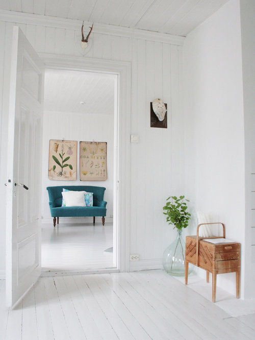 Scandinavian painted wood floor and white floor living room idea in Other  with white walls