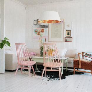 他の地域の小さい北欧スタイルのおしゃれなリビング (白い壁、白い床) の写真