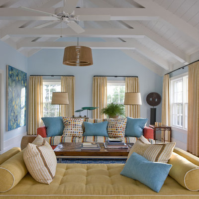 Example of an eclectic enclosed living room design in New York with blue walls and no tv