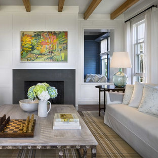 Design ideas for a small coastal enclosed living room in Boston with blue walls, porcelain flooring, a corner fireplace, a concrete fireplace surround and grey floors.