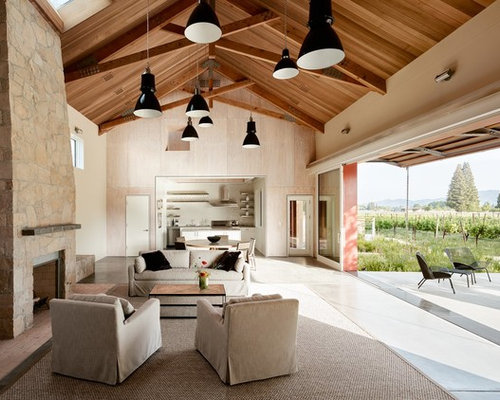 Example Of A Country Open Concept Concrete Floor And Gray Living Room Design In San