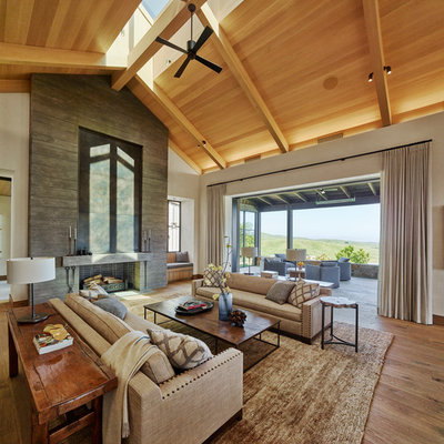 Mountain style formal and open concept medium tone wood floor and brown floor living room photo in San Francisco with a standard fireplace, a concrete fireplace and white walls