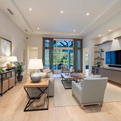 Example of a large transitional open concept living room design in Miami with white walls and a wall-mounted tv