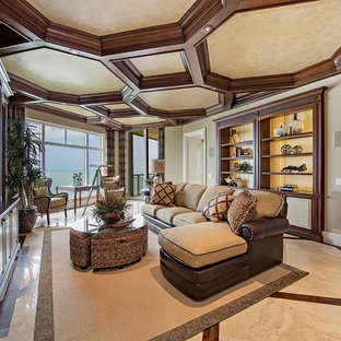 Island style living room photo in Miami with beige walls and a media wall