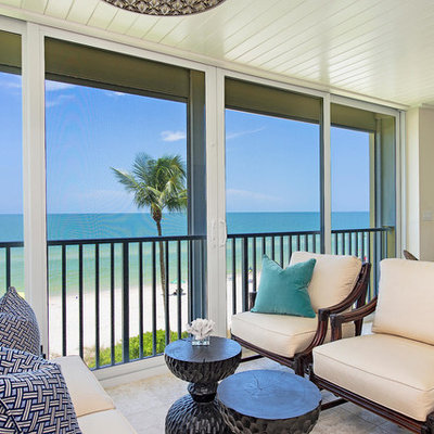 Inspiration for a large tropical formal and open concept ceramic tile and beige floor living room remodel in Miami with beige walls, no fireplace and no tv