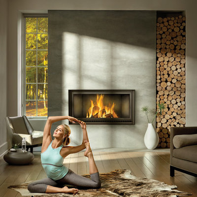 Example of a large trendy formal and open concept medium tone wood floor and gray floor living room design in Other with gray walls, a standard fireplace, a metal fireplace and no tv