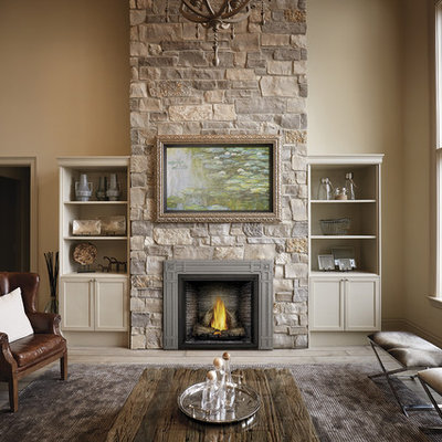 Living room - large traditional formal and enclosed medium tone wood floor and gray floor living room idea in Other with beige walls, a standard fireplace, a stone fireplace and no tv