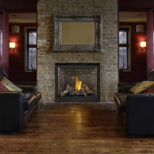 Photo of a medium sized rustic formal open plan living room in Other with brown walls, dark hardwood flooring, a standard fireplace, a stone fireplace surround, no tv and brown floors.