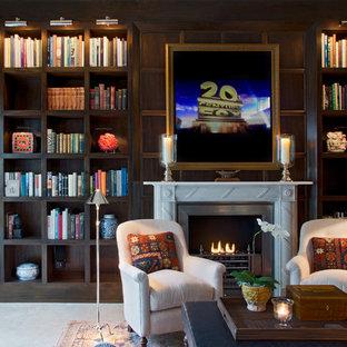 セントルイスの中くらいのトラディショナルスタイルのおしゃれなLDK (ライブラリー、コンクリートの床、標準型暖炉、内蔵型テレビ) の写真
