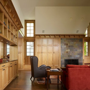 Inspiration for a mid-sized craftsman enclosed and formal medium tone wood floor living room remodel in Chicago with beige walls, a standard fireplace, a stone fireplace and no tv